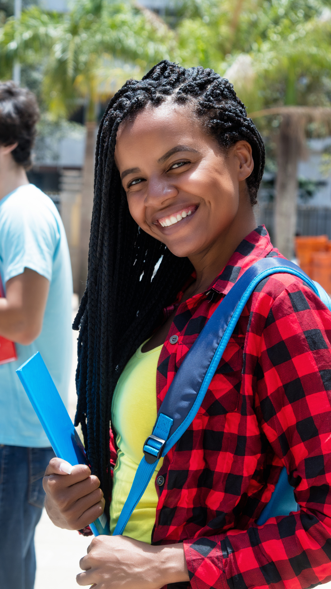 Smiling student outside with backpack